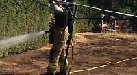 Head uses hose to tackle fire