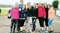 School mums walk through torrential rain for charity