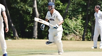 Griffiths hits winning runs to maintain pressure at top