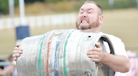 Strongman display pulls in crowds at school fun day