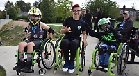 Skating-mad boy handed new wheelchair