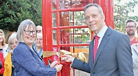 Defibrillator installed in former call box in memory of GP