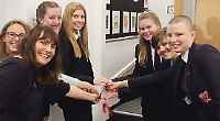 Teachers, pupils and parents toast new school library