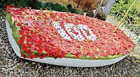 Boat decorated with poppy tapestry for remembrance