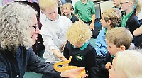 Pupils learn about exotic animals with zoo volunteer