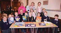 Author reads books to children as charity auction prize