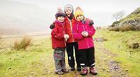 Children scale 886m Welsh mountain despite rain and 60mph winds