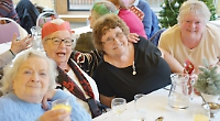 Elderly enjoy each other's company over traditional lunch thanks to Rotary