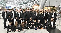 Swimmers win cup in twin town for first time