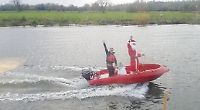 Santa arrives for lunch by boat