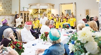 School choirs sings at care home party