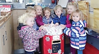 Excited children post letters to Santa