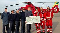 RAF base raises £1,000 for air ambulance