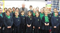 Conductor tells pupils about chilly concert for Queen