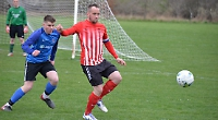 Lewis wraps up scoring as Town move to top of table
