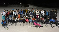 Skiing students enjoy quiet slopes in sunshine