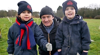 Pupils plant 100 trees around school's artificial pitch