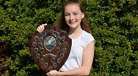 Teenager receives community award for charity work