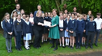 School presented with book in campaign to promote nature and literature