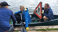 Volunteers clear rubbish from the river and towpath