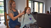 Girl, 9, has haircut to raise money for cancer sufferer