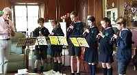 Pupils play recorder for hospice patients