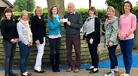 Flowers show presents £5,000 to school