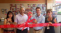 The ribbon being cut at the newly refurbished post office in Emmer Green