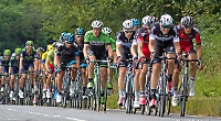 The Tour of Britain peleton with Sir Bradley Wiggins riding in the Sky team kit.